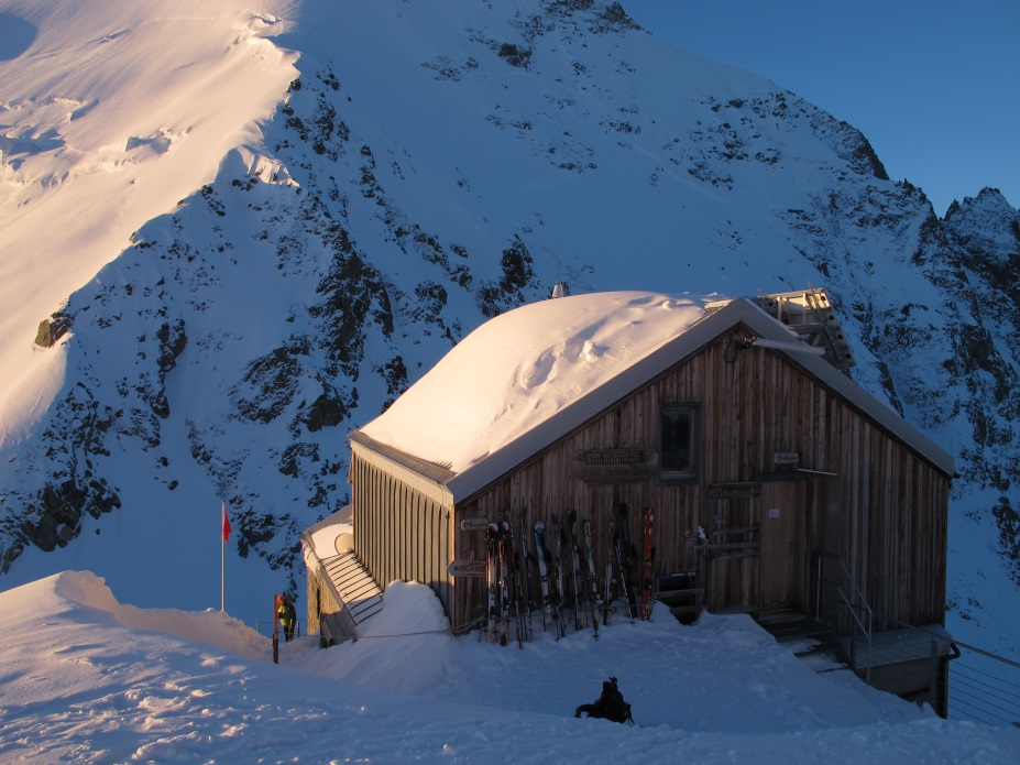 Hollandiahütte looking particularly welcoming under Alpenglow, Photo by Mark Houston