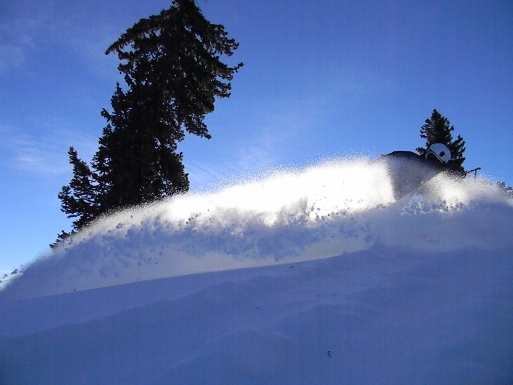snowboarding powder in Utah at solitude resort